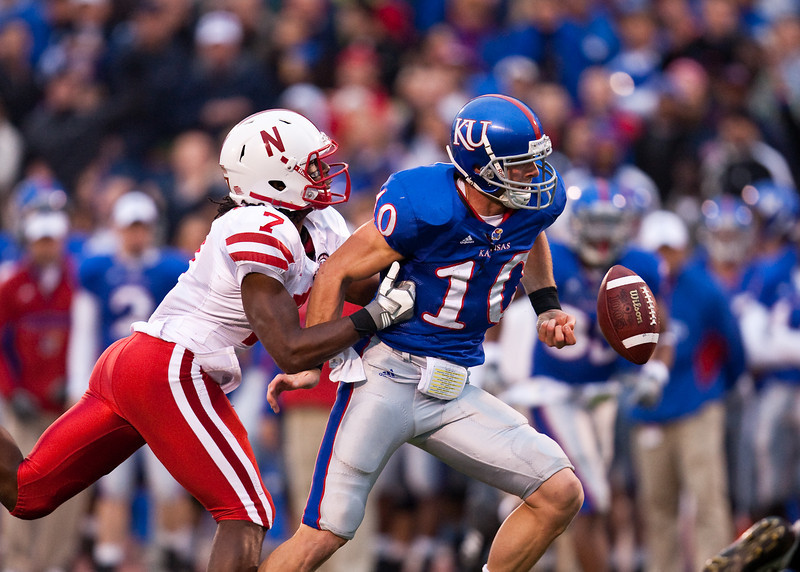 14 November 2009: Nebraska cornerback Dejon Gomes (7) forces Kansas wide receiver Kerry Meier (10) to fumble after the catch during the Nebraska Cornhuskers 31-17 win over the Kansas Jayhawks at Memorial Stadium in Lawrence, Kansas.