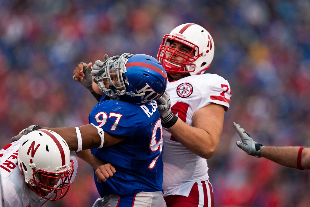 14 November 2009: Kansas defensive tackle Richard Johnson Jr. (97) battles with Nebraska offensive lineman Ricky Henry (74) during the Nebraska Cornhuskers 31-17 win over the Kansas Jayhawks at Memorial Stadium in Lawrence, Kansas.