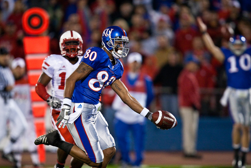14 November 2009: Kansas wide receiver Dezmon Briscoe (80) scores on a 21 yard touchdown pass from quarterback Todd Reesing during the Nebraska Cornhuskers 31-17 win over the Kansas Jayhawks at Memorial Stadium in Lawrence, Kansas.