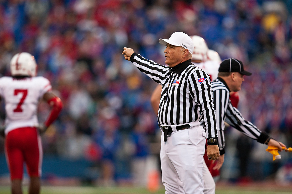 14 November 2009: Referee Cooper Castleberry explains a penalty during the Nebraska Cornhuskers 31-17 win over the Kansas Jayhawks at Memorial Stadium in Lawrence, Kansas.