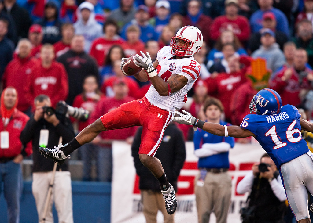 14 November 2009: Nebraska wide receiver Niles Paul (24) hauls in a pass in front of Kansas cornerback Chris Harris (16) during the Nebraska Cornhuskers 31-17 win over the Kansas Jayhawks at Memorial Stadium in Lawrence, Kansas.