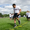 Emiliano Pastorino, 12, performs a drill during the New England Patriots Alumni Club's annual Football For You youth football clinic at Crocker Field on Thursday. SENTINEL & ENTERPRISE / Ashley Green