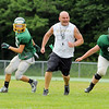 Oakmont's new head coach Charlie Raff gets fired up after a good play by his defense during practice on Thursday morning. SENTINEL & ENTERPRISE/JOHN LOVE