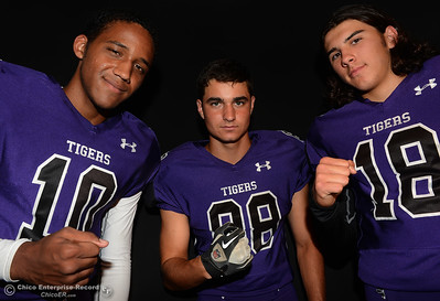 Jacob Harrigan (10), Colton Roger (18) and Hunter Monnot (88) in an Oroville Tigers studio photo shoot Saturday, Aug. 13, 2016, at the Enterprise-Record in Chico, California. (Dan Reidel -- Enterprise-Record)