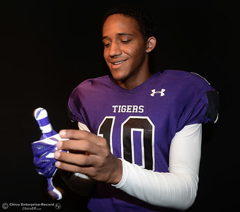 Oroville Tigers footballer Jacob Harrigan puts on a glove at a studio photo shoot Saturday, Aug. 13, 2016, at the Enterprise-Record in Chico, California. (Dan Reidel -- Enterprise-Record)