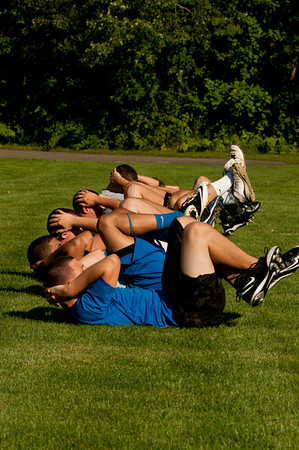 Members of the Plainvile High School football team workout in the first practice of the season