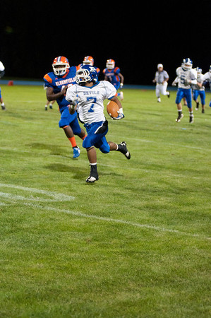 Kevin Waite runs a kickoff back for a touchdown Friday night against Bloomfield.