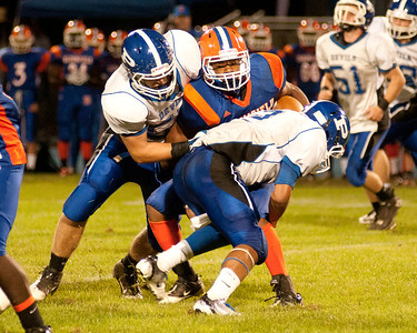 Plainville defenders wrap up a Bloomfield runner.