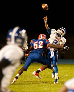 Plainville  QB Tony Lopizzo throws up a pass just before getting hit by a Bloomfiled defender.