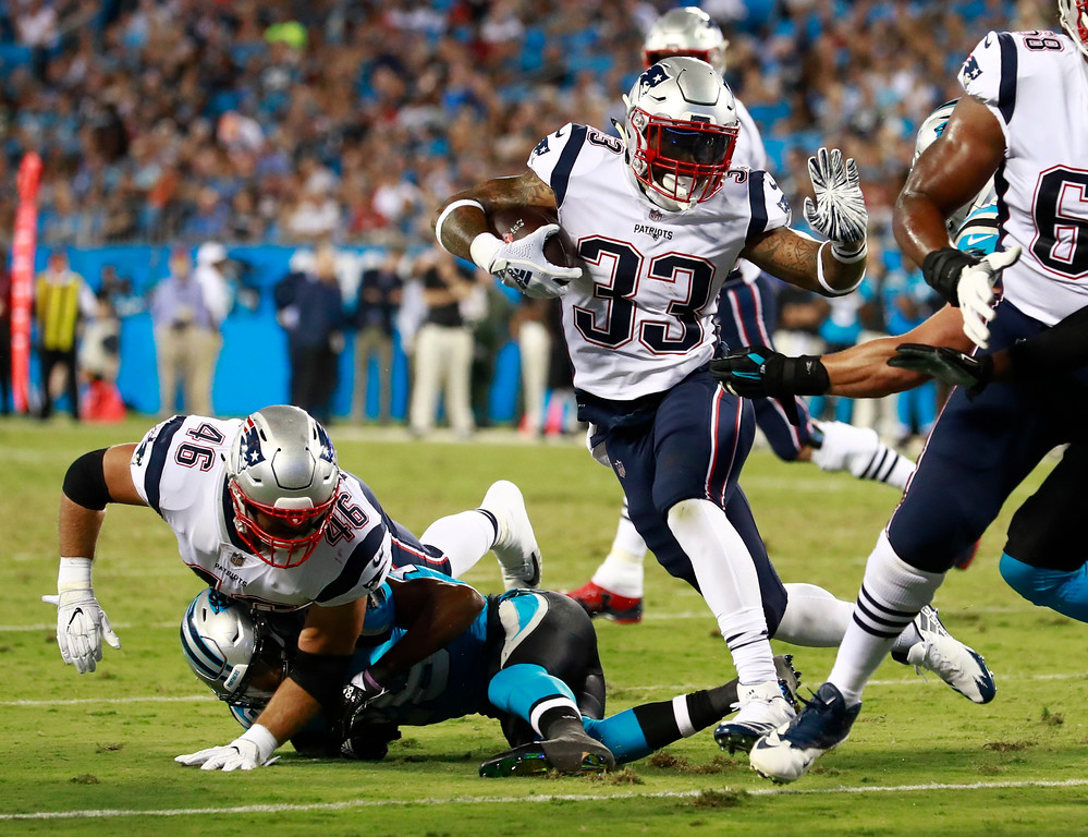. New England Patriots\' Jeremy Hill (33) runs against the Carolina Panthers during the first half of a preseason NFL football game in Charlotte, N.C., Friday, Aug. 24, 2018. (AP Photo/Jason E. Miczek)