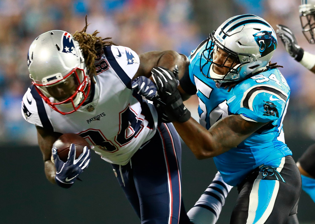 . Carolina Panthers\' Shaq Green-Thompson (54) hits New England Patriots\' Cordarrelle Patterson (84) during the first half of a preseason NFL football game in Charlotte, N.C., Friday, Aug. 24, 2018. (AP Photo/Jason E. Miczek)