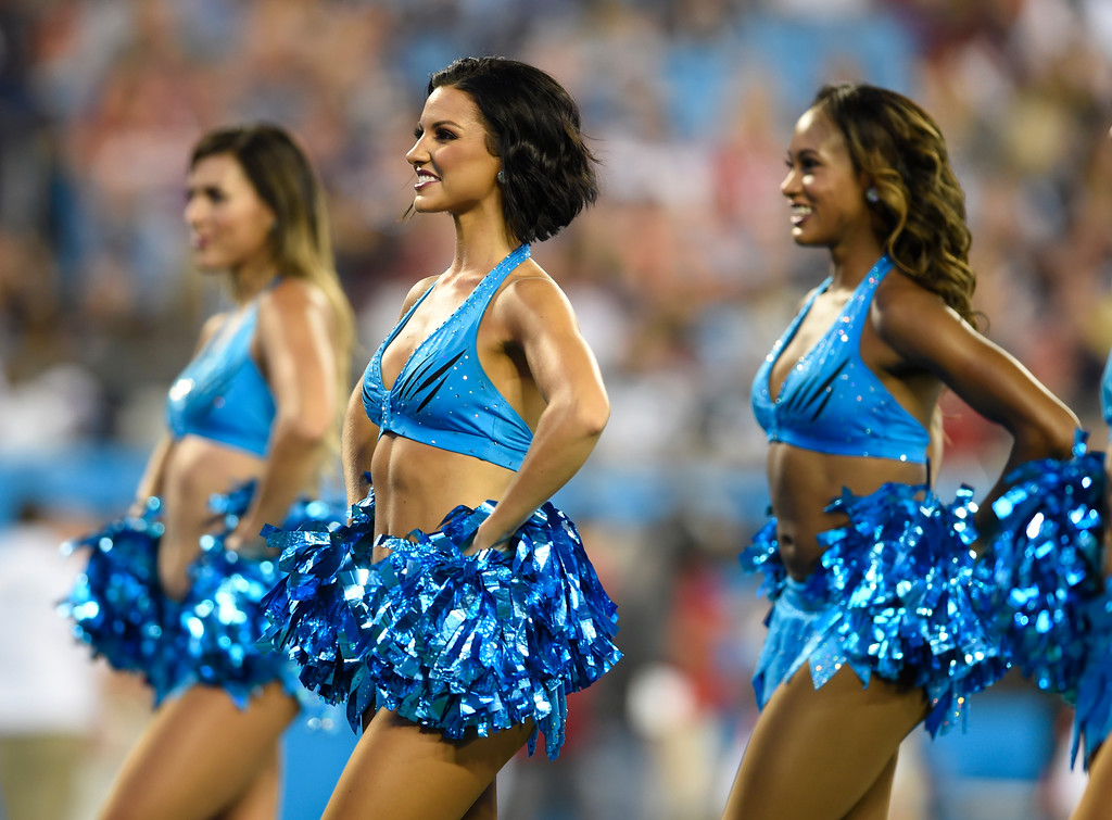 . Carolina Panthers cheerleaders perform during the first half of a preseason NFL football game against the New England Patriots in Charlotte, N.C., Friday, Aug. 24, 2018. (AP Photo/Mike McCarn)