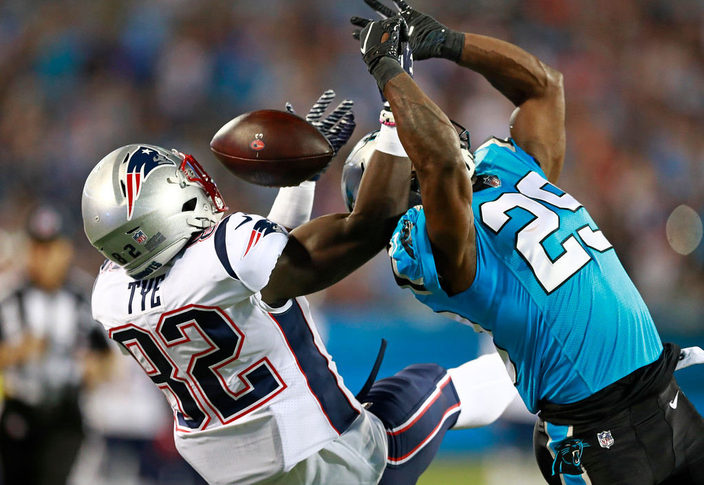 . Carolina Panthers\' Mike Adams (29) knocks a pass away from New England Patriots\' Will Tye (82) during the first half of a preseason NFL football game in Charlotte, N.C., Friday, Aug. 24, 2018. (AP Photo/Jason E. Miczek)