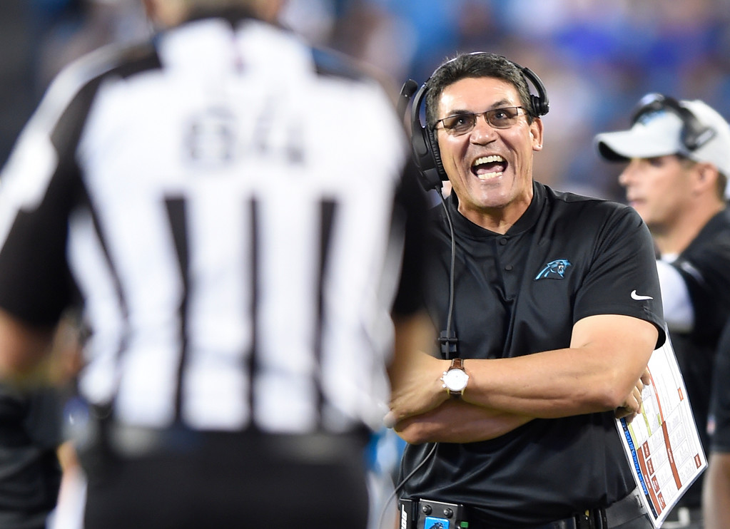 . Carolina Panthers head coach Ron Rivera reacts to a call during the first half of a preseason NFL football game against the New England Patriots in Charlotte, N.C., Friday, Aug. 24, 2018. (AP Photo/Mike McCarn)