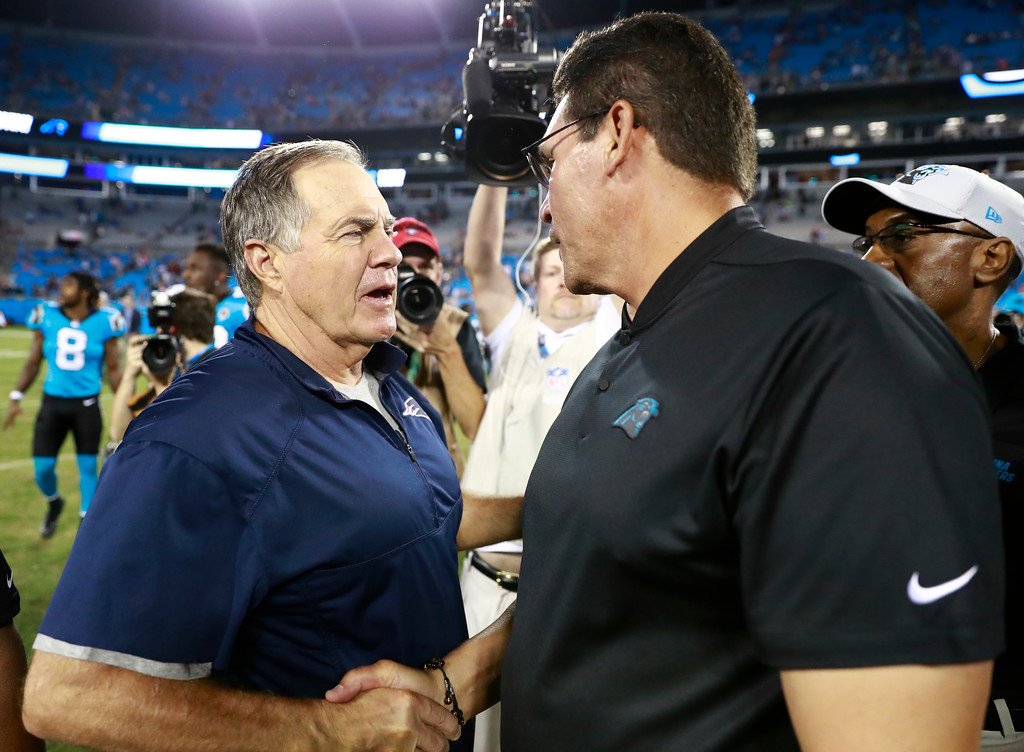 . Carolina Panthers head coach Ron Rivera, right, greets New England Patriots head coach Bill Belichick, left, after a preseason NFL football game in Charlotte, N.C., Friday, Aug. 24, 2018. (AP Photo/Jason E. Miczek)