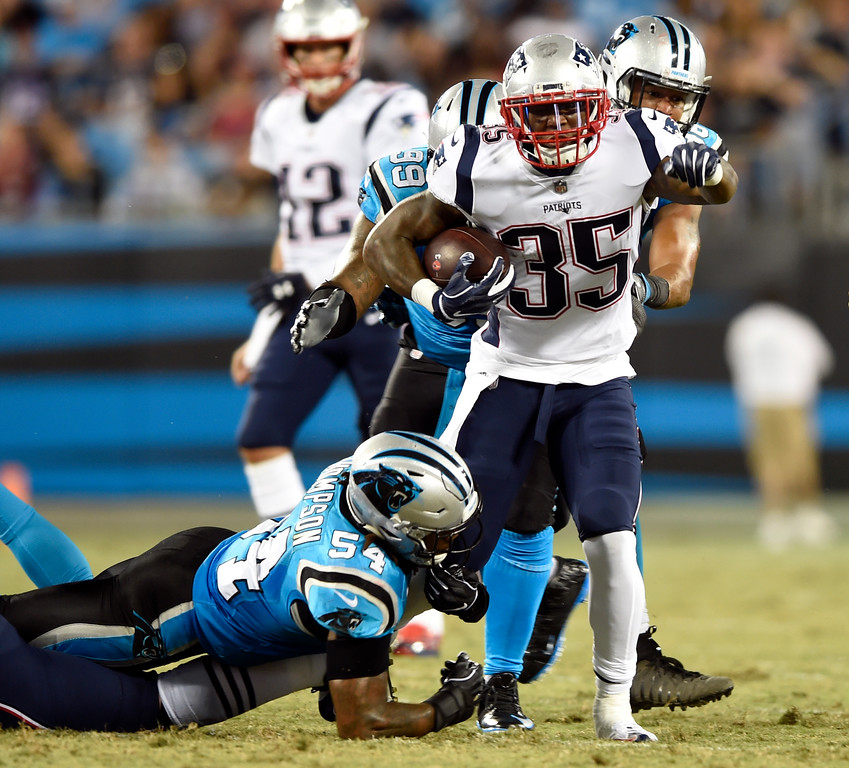 . New England Patriots\' Mike Gillislee (35) is tackled by Carolina Panthers\' Shaq Green-Thompson (54) during the first half of a preseason NFL football game in Charlotte, N.C., Friday, Aug. 24, 2018. (AP Photo/Mike McCarn)