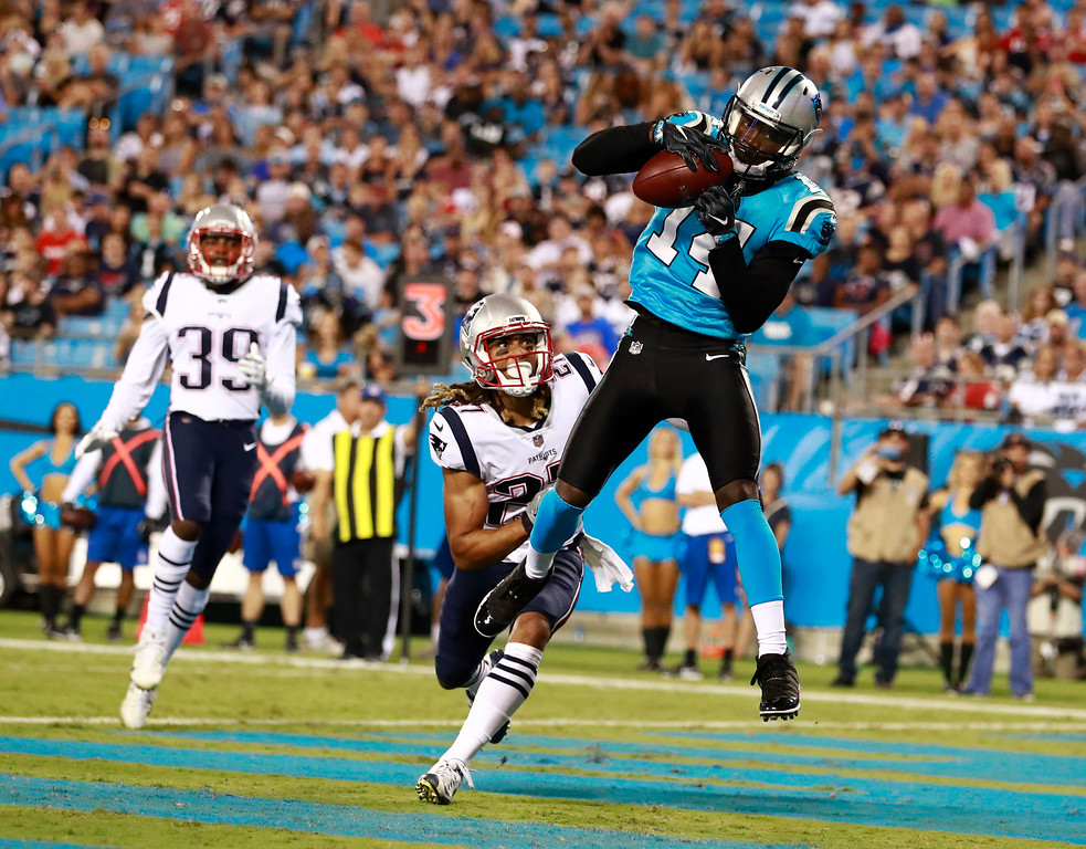. Carolina Panthers\' Mose Frazier (14) catches a touchdown pass against New England Patriots\' Ryan Lewis (27) during the second half of a preseason NFL football game in Charlotte, N.C., Friday, Aug. 24, 2018. (AP Photo/Jason E. Miczek)