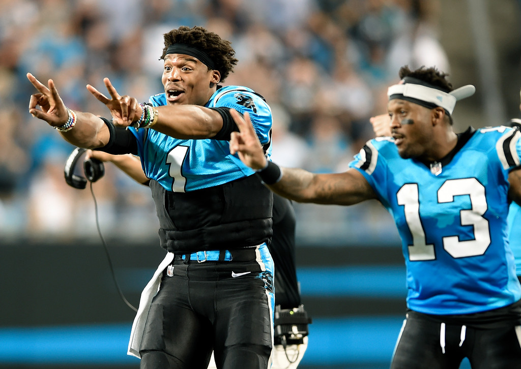 . Carolina Panthers\' Cam Newton (1) and Jarius Wright (13) gesture from the sidelines for a 2-point conversion after a touchdown against the New England Patriots during the second half of a preseason NFL football game in Charlotte, N.C., Friday, Aug. 24, 2018. (AP Photo/Mike McCarn)
