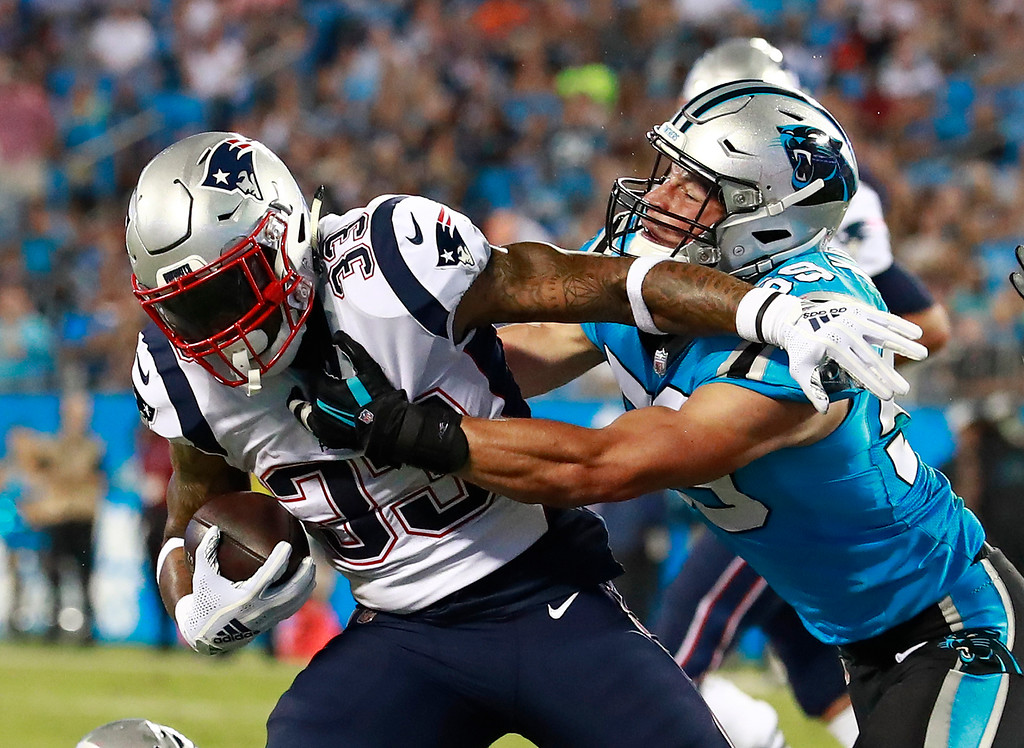 . New England Patriots\' Jeremy Hill (33) is tackled by Carolina Panthers\' Luke Kuechly (59) during the first half of a preseason NFL football game in Charlotte, N.C., Friday, Aug. 24, 2018. (AP Photo/Jason E. Miczek)