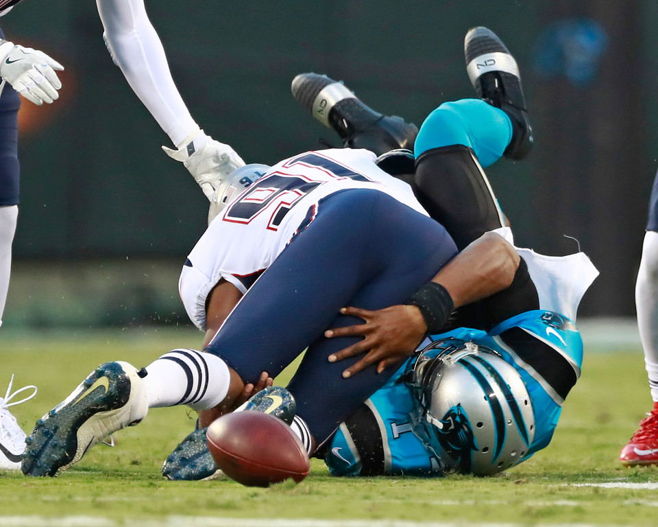 . Carolina Panthers\' Cam Newton (1) fumbles as he is hit by New England Patriots\' Deatrich Wise (91) during the first half of a preseason NFL football game in Charlotte, N.C., Friday, Aug. 24, 2018. (AP Photo/Jason E. Miczek)