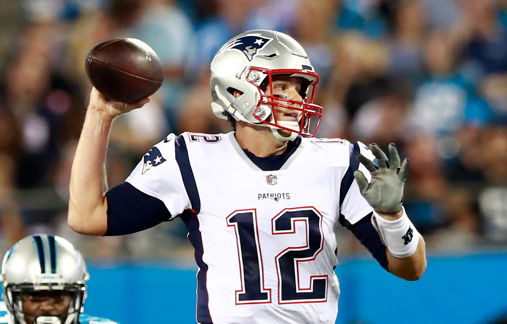 . New England Patriots\' Tom Brady (12) throws a pass against the Carolina Panthers during the first half of a preseason NFL football game in Charlotte, N.C., Friday, Aug. 24, 2018. (AP Photo/Jason E. Miczek)
