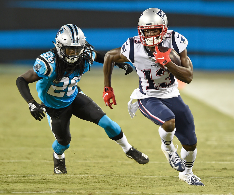 . New England Patriots\' Phillip Dorsett (13) runs past Carolina Panthers\' Donte Jackson (26) during the first half of a preseason NFL football game in Charlotte, N.C., Friday, Aug. 24, 2018. (AP Photo/Mike McCarn)