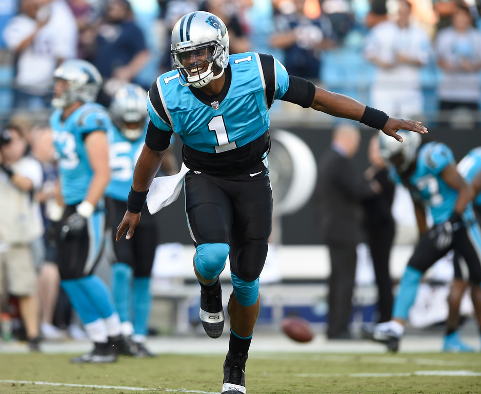 . Carolina Panthers\' Cam Newton (1) warms up before a preseason NFL football game against the New England Patriots in Charlotte, N.C., Friday, Aug. 24, 2018. (AP Photo/Mike McCarn)