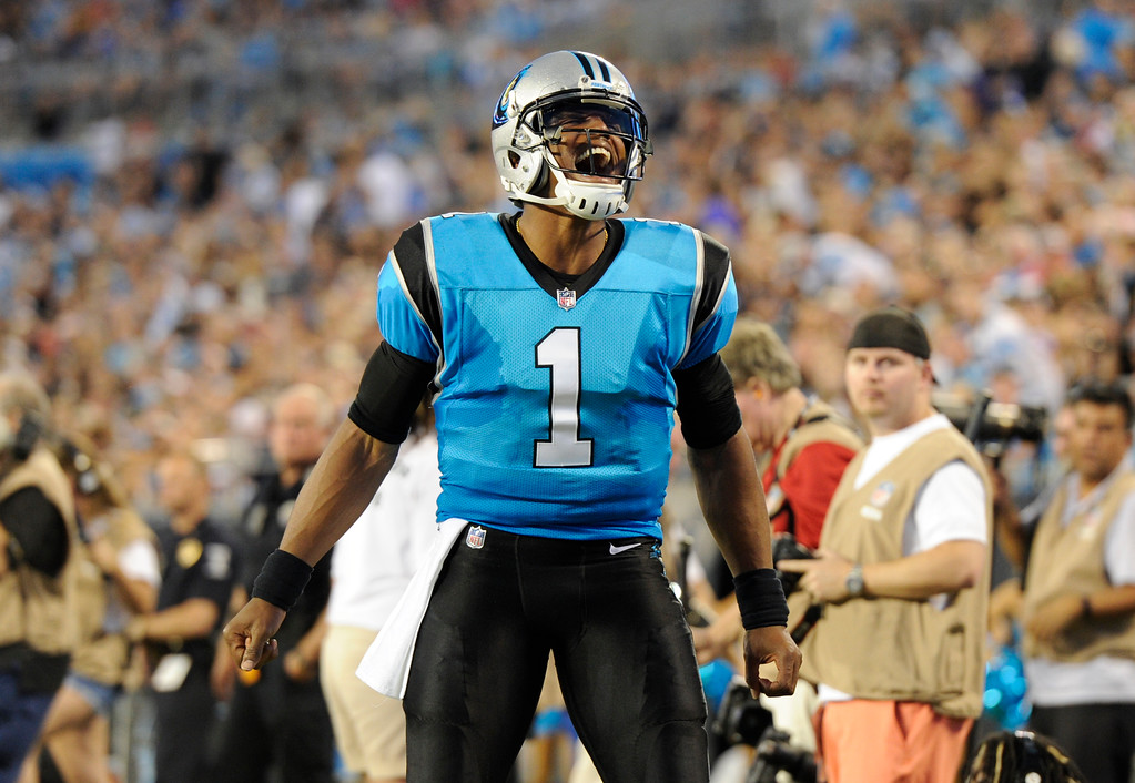 . Carolina Panthers\' Cam Newton (1) reacts after a play against the New England Patriots during the first half of a preseason NFL football game in Charlotte, N.C., Friday, Aug. 24, 2018. (AP Photo/Mike McCarn)