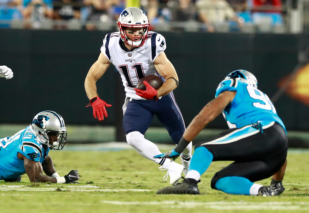 . New England Patriots\' Julian Edelman (11) runs as Carolina Panthers\' Wes Horton (96) defends during the first half of a preseason NFL football game in Charlotte, N.C., Friday, Aug. 24, 2018. (AP Photo/Jason E. Miczek)
