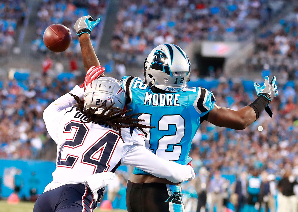 . New England Patriots\' Stephon Gilmore (24) knocks a pass away from Carolina Panthers\' DJ Moore (12) during the first half of a preseason NFL football game in Charlotte, N.C., Friday, Aug. 24, 2018. (AP Photo/Jason E. Miczek)