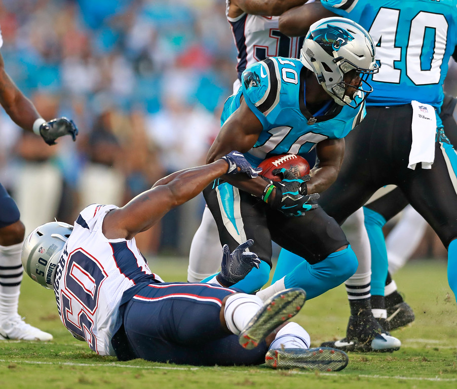 . Carolina Panthers\' Curtis Samuel (10) runs as New England Patriots\' Nicholas Grigsby (50) defends during the first half of a preseason NFL football game in Charlotte, N.C., Friday, Aug. 24, 2018. (AP Photo/Jason E. Miczek)