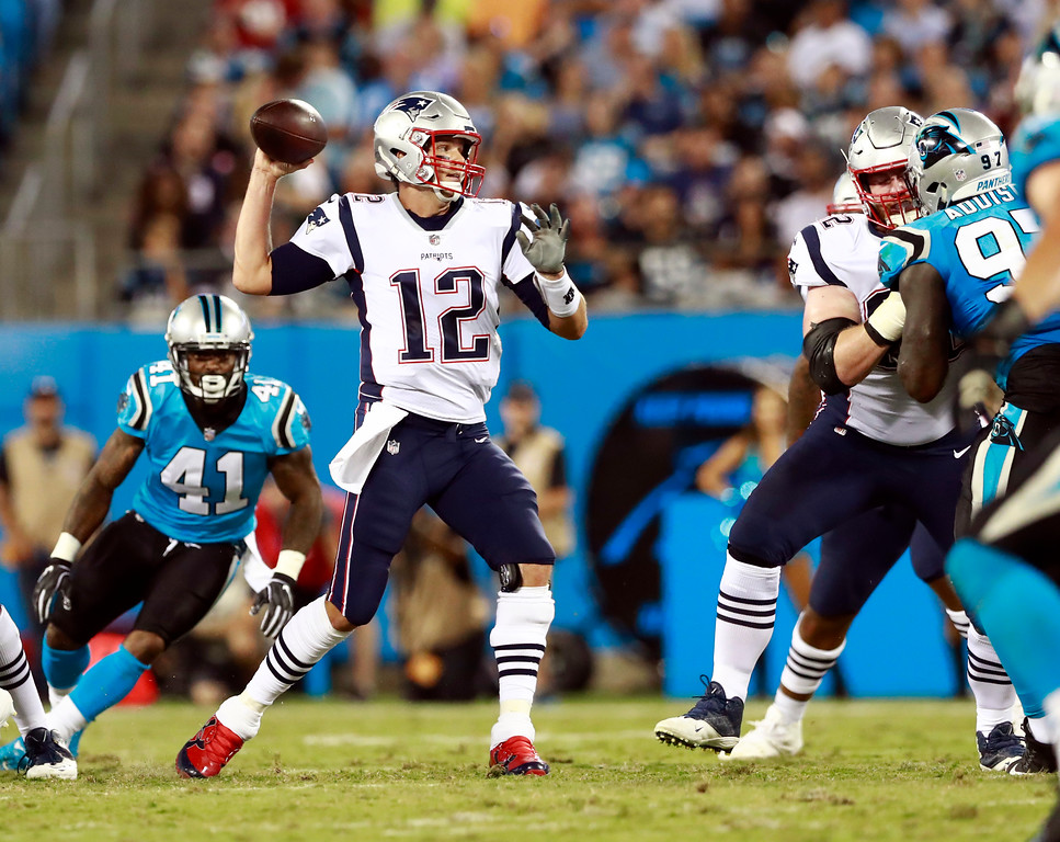 . New England Patriots\' Tom Brady (12) looks to pass against the Carolina Panthers during the first half of a preseason NFL football game in Charlotte, N.C., Friday, Aug. 24, 2018. (AP Photo/Jason E. Miczek)
