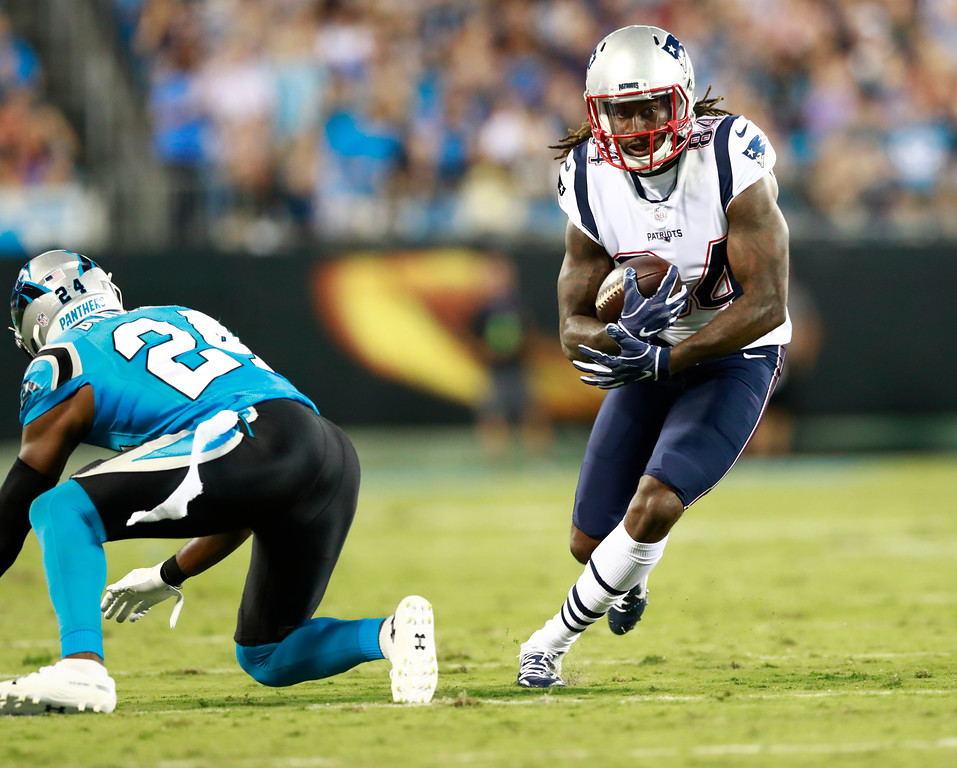 . New England Patriots\' Cordarrelle Patterson (84) runs past Carolina Panthers\' James Bradberry (24) after a catch during the first half of a preseason NFL football game in Charlotte, N.C., Friday, Aug. 24, 2018. (AP Photo/Jason E. Miczek)