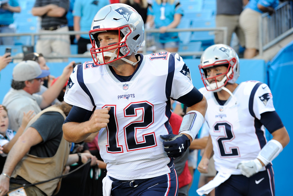 . New England Patriots\' Tom Brady (12) takes the field before a preseason NFL football game against the Carolina Panthers in Charlotte, N.C., Friday, Aug. 24, 2018. (AP Photo/Mike McCarn)