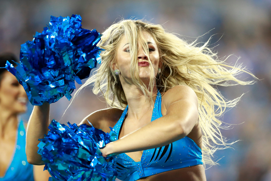 . A Carolina Panthers cheerleader performs during the first half of a preseason NFL football game against the New England Patriots in Charlotte, N.C., Friday, Aug. 24, 2018. (AP Photo/Jason E. Miczek)