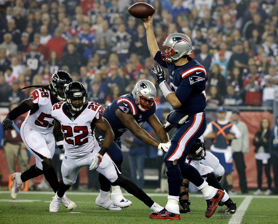 . New England Patriots quarterback Tom Brady, right, passes under pressure from Atlanta Falcons linebacker De\'Vondre Campbell (59) and safety Keanu Neal (22) during the first half of an NFL football game, Sunday, Oct. 22, 2017, in Foxborough, Mass. (AP Photo/Steven Senne)
