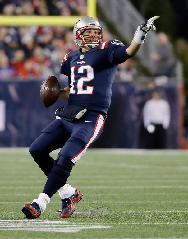 . New England Patriots quarterback Tom Brady signals to a receiver as he rolls out to pass during the first half of an NFL football game against the Atlanta Falcons, Sunday, Oct. 22, 2017, in Foxborough, Mass. (AP Photo/Steven Senne)