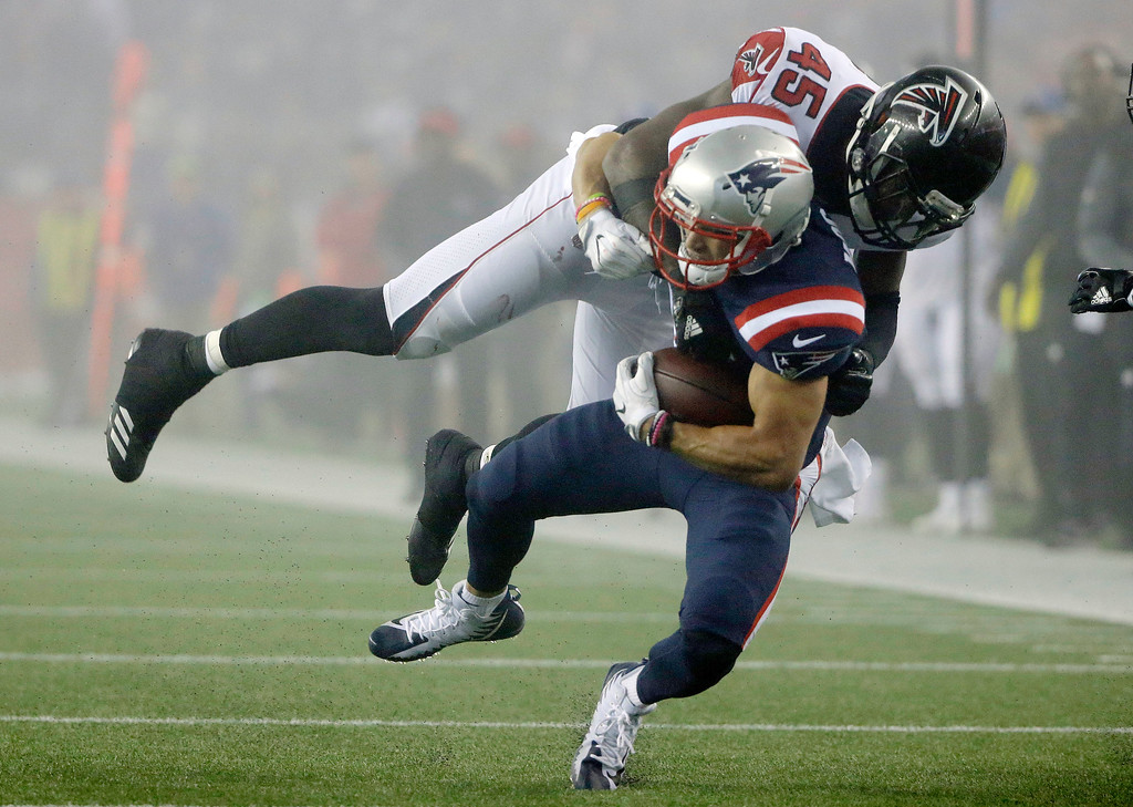 . Atlanta Falcons linebacker Deion Jones (45) tackles New England Patriots wide receiver Chris Hogan (15) during the second half of an NFL football game, Sunday, Oct. 22, 2017, in Foxborough, Mass. (AP Photo/Steven Senne)