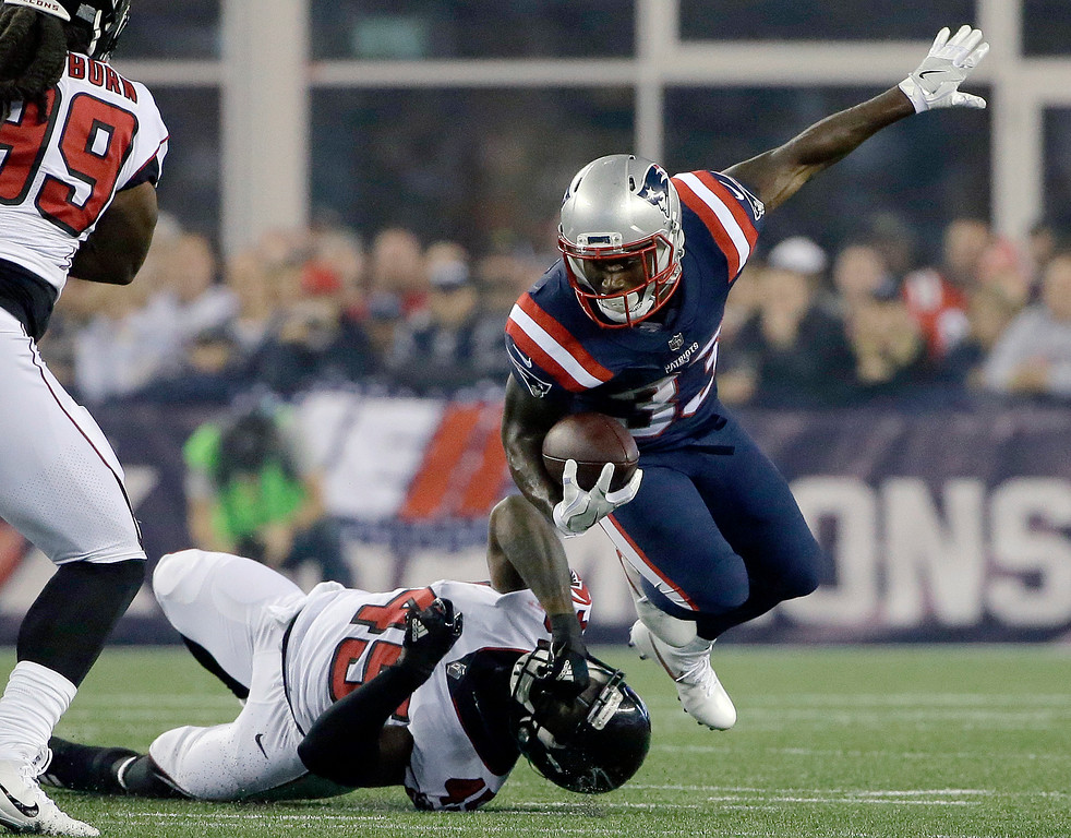 . Atlanta Falcons linebacker Deion Jones (45) tackles New England Patriots running back Dion Lewis (33) during the first half of an NFL football game, Sunday, Oct. 22, 2017, in Foxborough, Mass. (AP Photo/Steven Senne)
