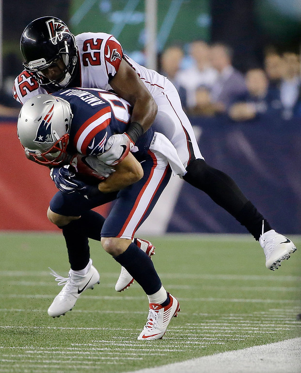 . Atlanta Falcons safety Keanu Neal (22) tackles New England Patriots wide receiver Danny Amendola (80) during the first half of an NFL football game, Sunday, Oct. 22, 2017, in Foxborough, Mass. (AP Photo/Steven Senne)