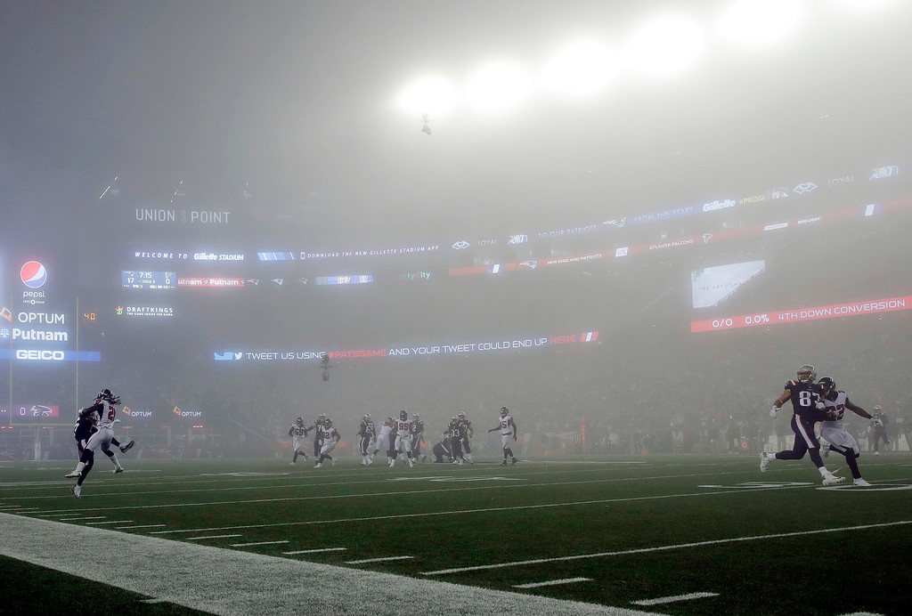 . Fog settles over the field during the second half of an NFL football game between the New England Patriots and the Atlanta Falcons, Sunday, Oct. 22, 2017, in Foxborough, Mass. (AP Photo/Charles Krupa)