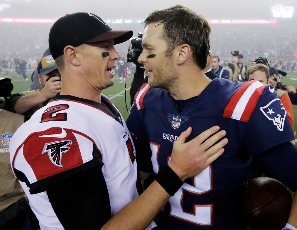 . Atlanta Falcons quarterback Matt Ryan, left, and New England Patriots quarterback Tom Brady, right, speak at midfield after an NFL football game, Sunday, Oct. 22, 2017, in Foxborough, Mass. (AP Photo/Steven Senne)