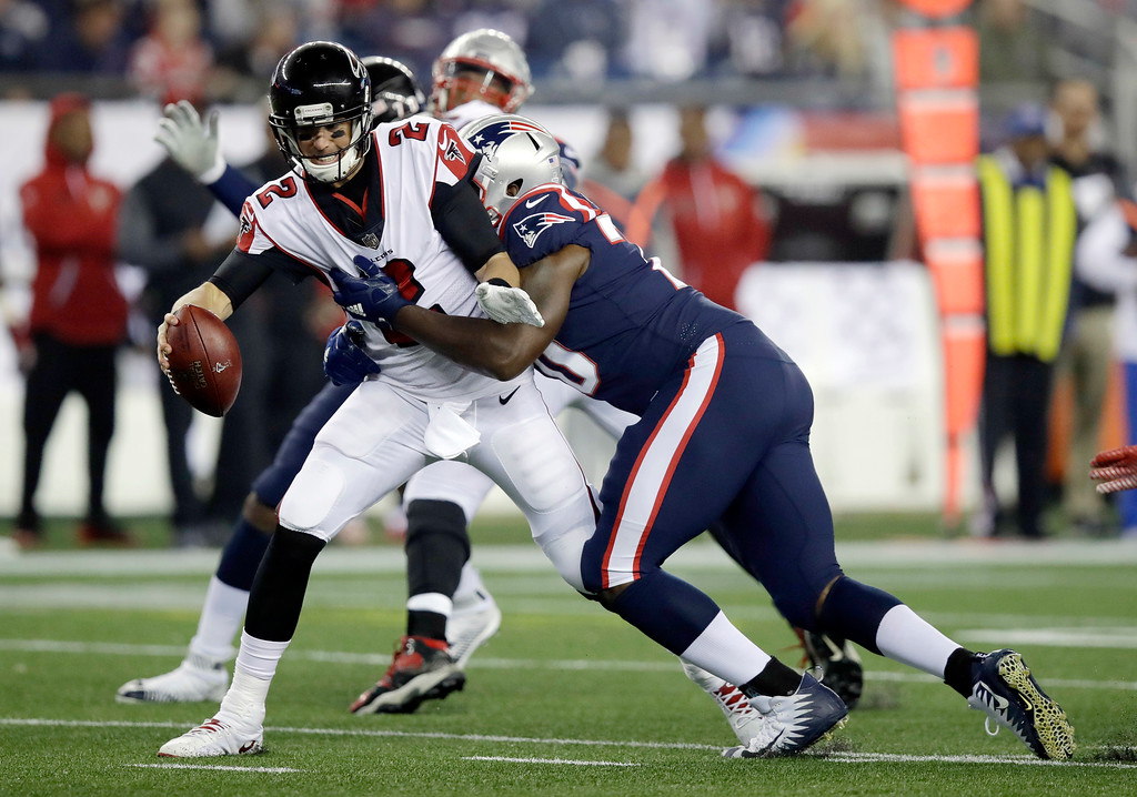 . New England Patriots defensive tackle Adam Butler, right, sacks Atlanta Falcons quarterback Matt Ryan during the first half of an NFL football game, Sunday, Oct. 22, 2017, in Foxborough, Mass. (AP Photo/Charles Krupa)