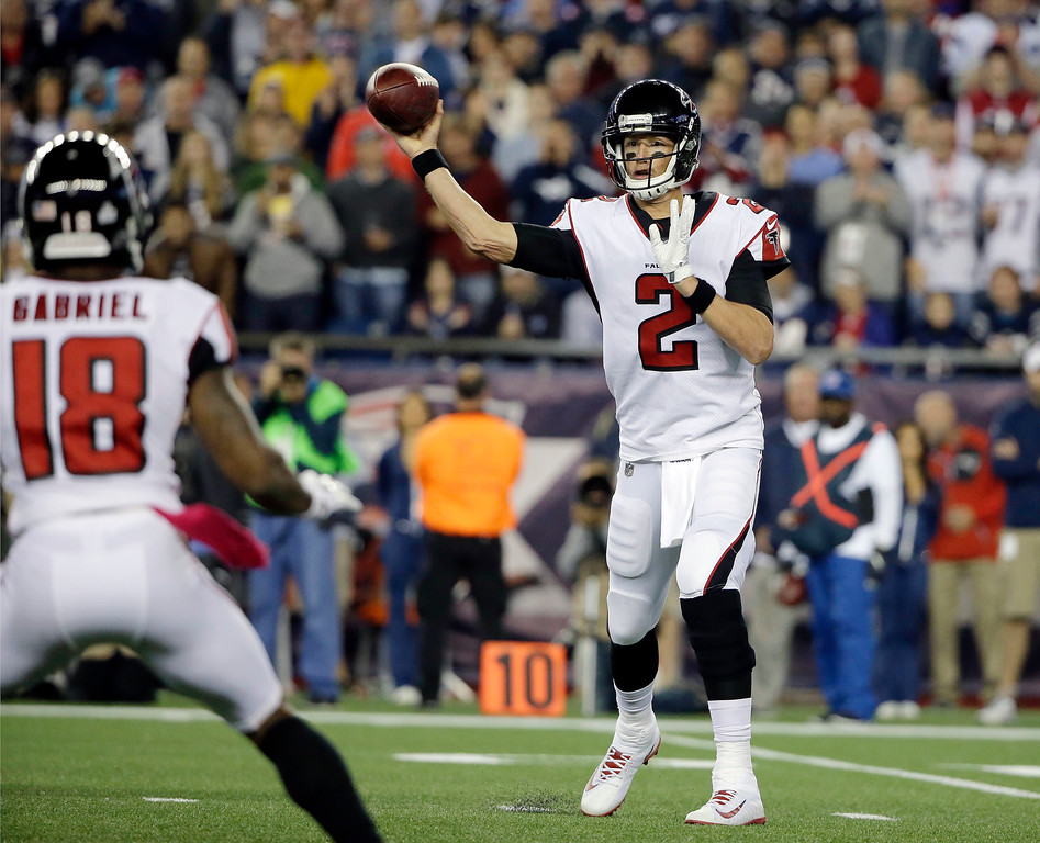 . Atlanta Falcons quarterback Matt Ryan (2) passes to wide receiver Taylor Gabriel (18) during the first half of an NFL football game against the New England Patriots, Sunday, Oct. 22, 2017, in Foxborough, Mass. (AP Photo/Steven Senne)