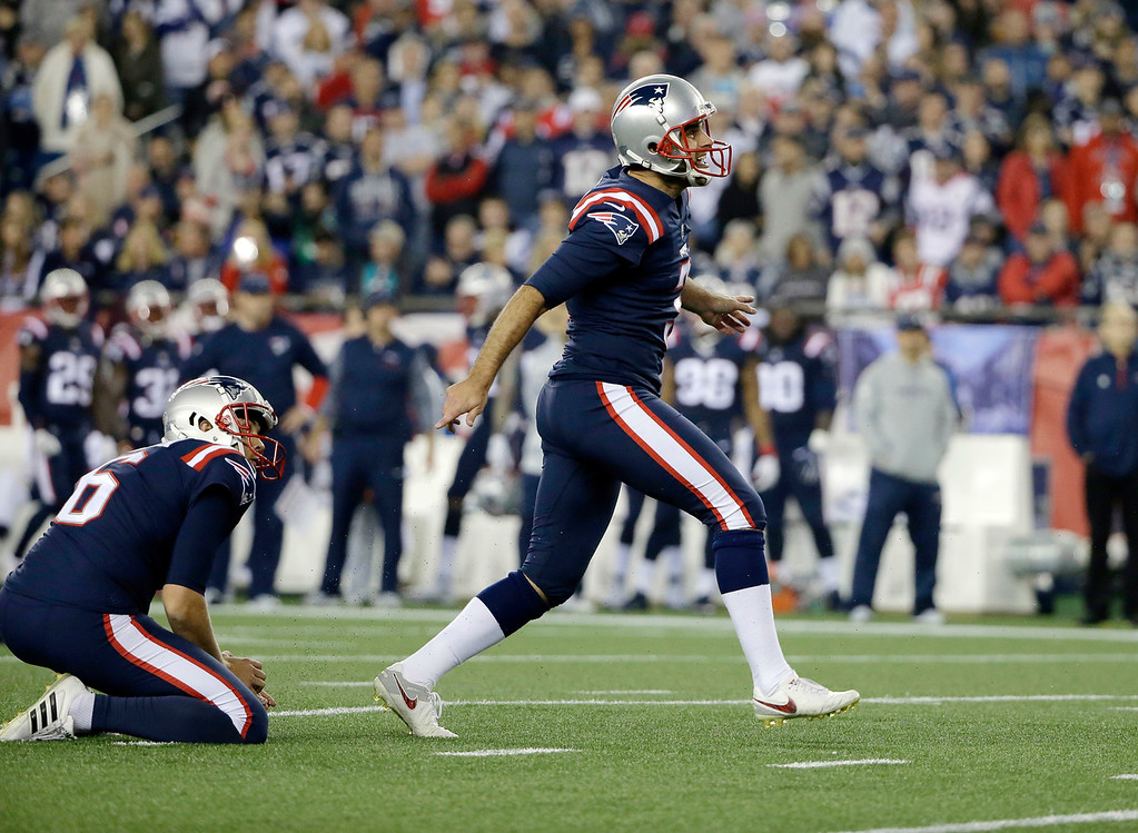 . New England Patriots kicker Stephen Gostkowski, right, watches his field goal against the Atlanta Falcons during the first half of an NFL football game, Sunday, Oct. 22, 2017, in Foxborough, Mass. (AP Photo/Steven Senne)