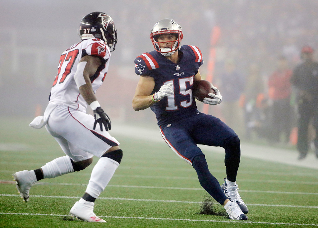 . New England Patriots wide receiver Chris Hogan (15) runs after catching a pass while Atlanta Falcons safety Ricardo Allen (37) pursues during the second half of an NFL football game, Sunday, Oct. 22, 2017, in Foxborough, Mass. (AP Photo/Steven Senne)