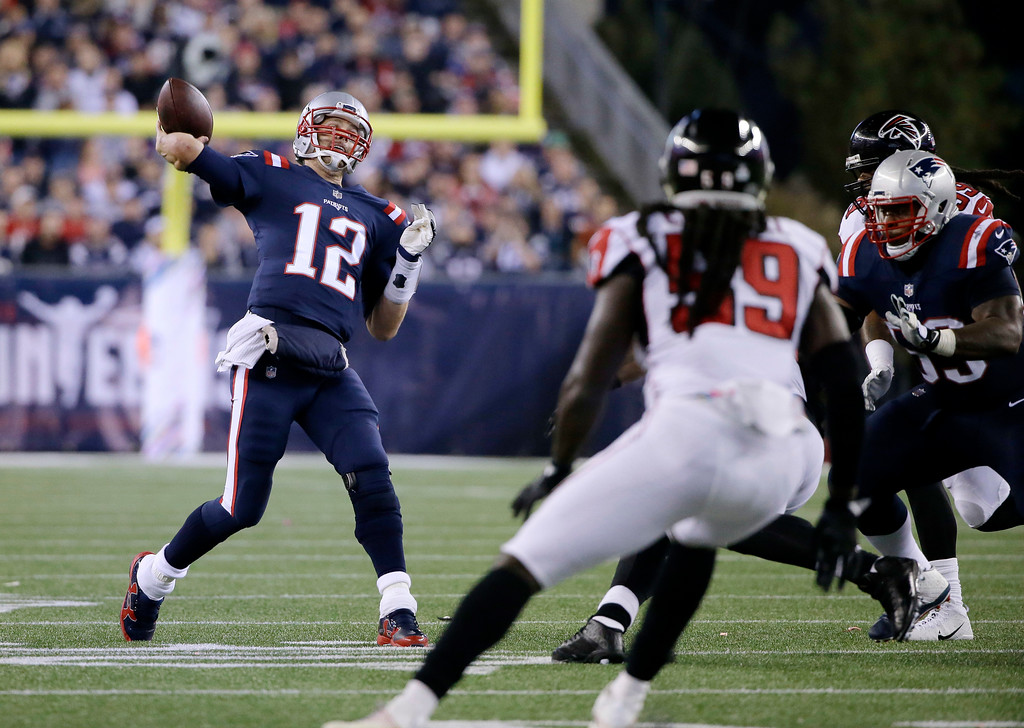 . New England Patriots quarterback Tom Brady passes under pressure from Atlanta Falcons linebacker De\'Vondre Campbell (59) during the first half of an NFL football game against the Atlanta Falcons, Sunday, Oct. 22, 2017, in Foxborough, Mass. (AP Photo/Steven Senne)