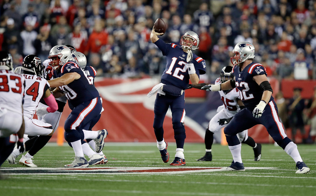 . New England Patriots quarterback Tom Brady passes against the Atlanta Falcons during the first half of an NFL football game, Sunday, Oct. 22, 2017, in Foxborough, Mass. (AP Photo/Charles Krupa)