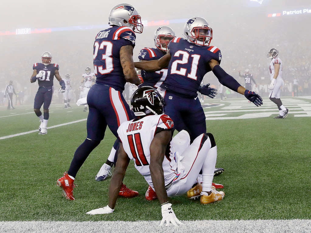 . New England Patriots cornerback Malcolm Butler (21) celebrates in the end zone with teammates after breaking up a pass intended for Atlanta Falcons wide receiver Julio Jones (11) during the second half of an NFL football game, Sunday, Oct. 22, 2017, in Foxborough, Mass. (AP Photo/Charles Krupa)