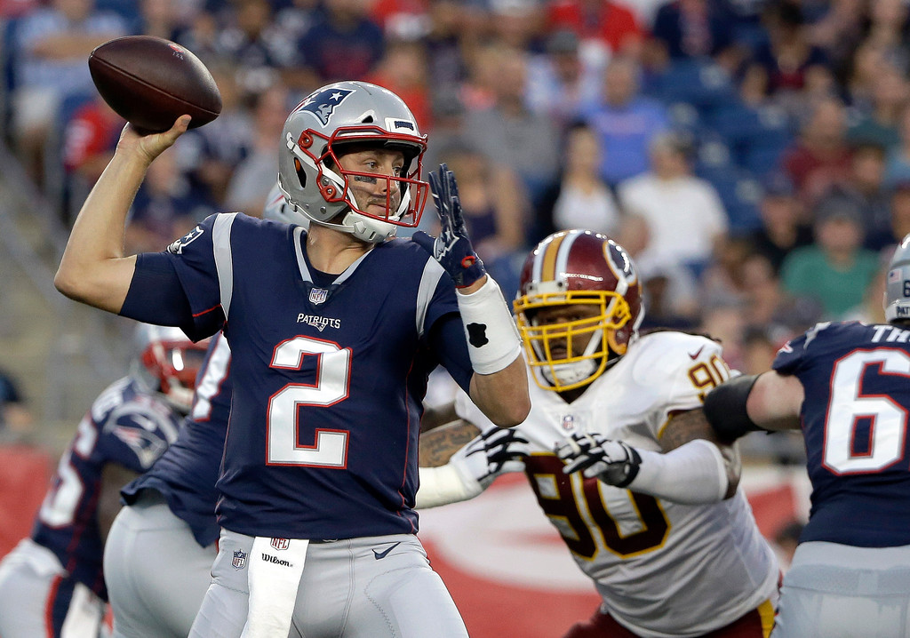 . New England Patriots quarterback Brian Hoyer (2) passes under pressure from Washington Redskins defensive tackle Ziggy Hood (90) during the first half of a preseason NFL football game, Thursday, Aug. 9, 2018, in Foxborough, Mass. (AP Photo/Steven Senne)